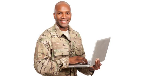 picture of a soldier holding a laptop