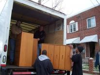 Image of movers unloading furniture